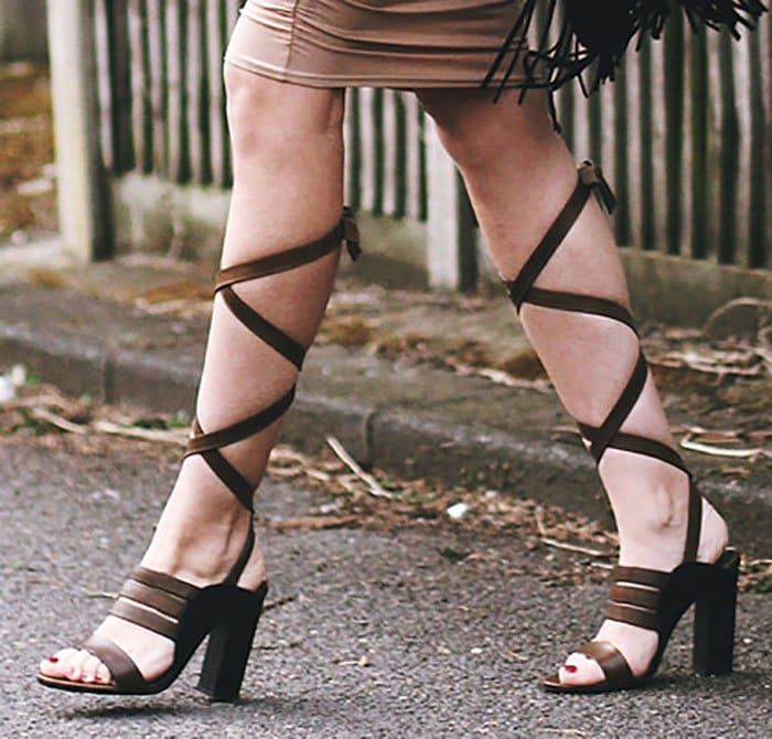 Gabriele showed off her feet in ankle-wrap sandals