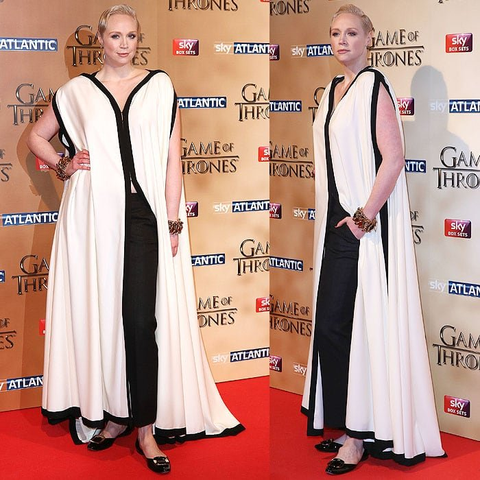 "Gwendoline Christie embraced every inch of her 6'3"" height in a majestic Jean Paul Gaultier Spring 2015 couture cape paired with black trousers and black Roger Vivier buckle flats"