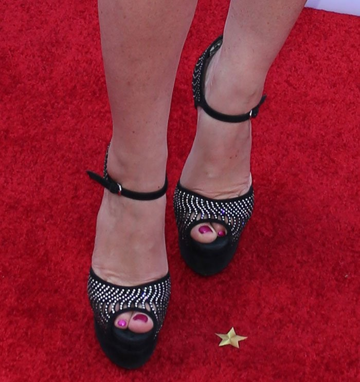 Idina Menzel's hot pedicured toes in Brian Atwood sandals