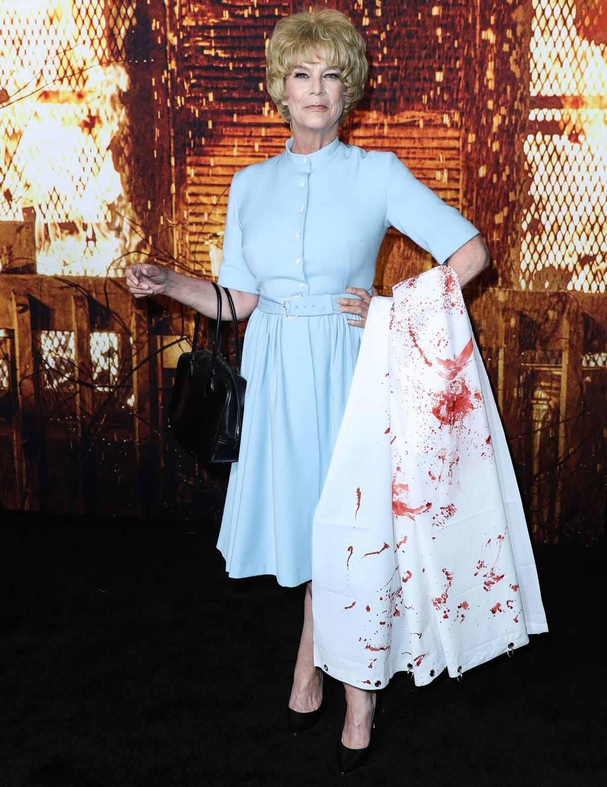 Wearing a costume inspired by her mom Janet Leigh's famous role from Psycho, Jamie Lee Curtis attends the premiere of her new movie Halloween Kills