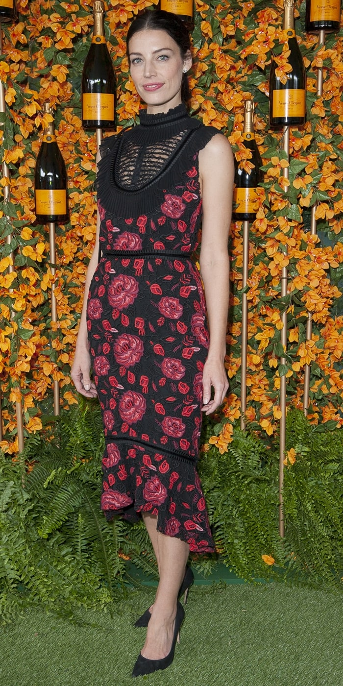 Jessica Pare flashes her legs in a floral print dress and black pumps