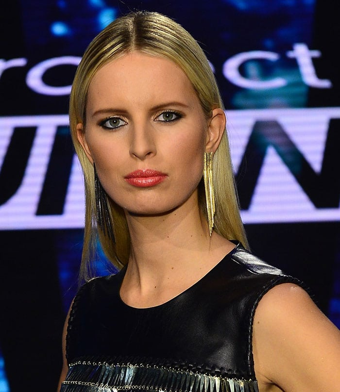 Karolina Kurkova wore her blonde hair straight with a center part to highlight her long fringed earrings