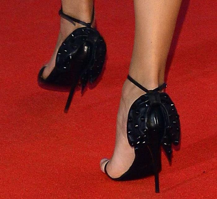 Karolina Kurkova's shoes featuring studded bows at the back