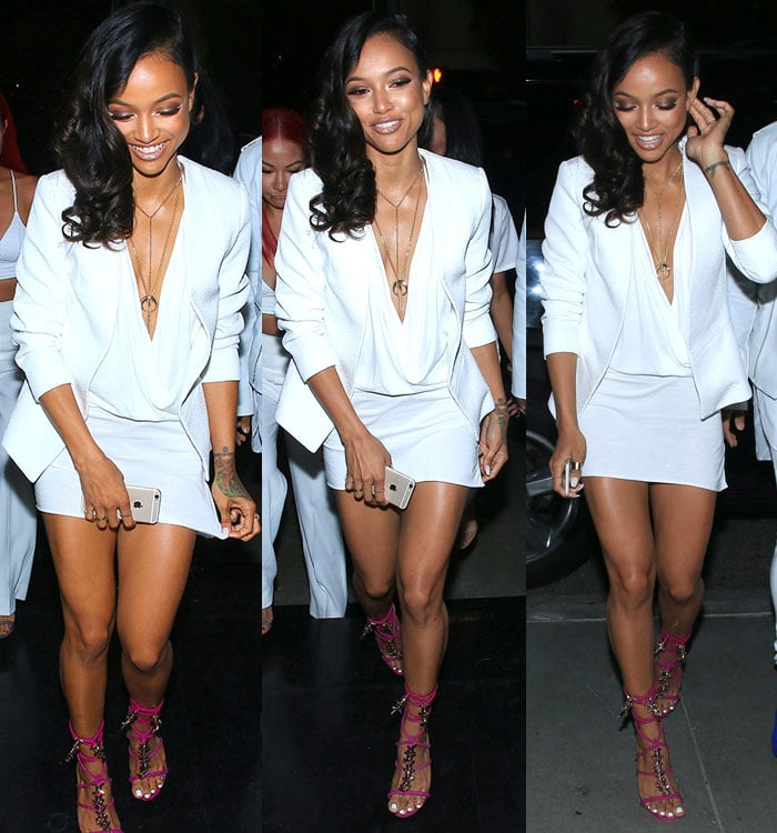 Karrueche Tran paraded her legs in adraped dress featuring a plunging neckline