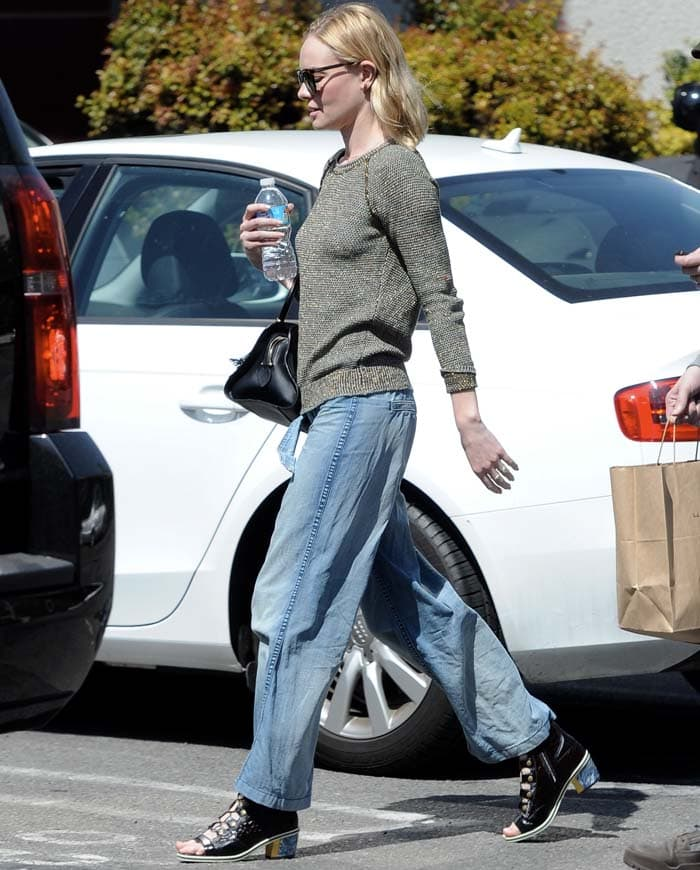 Actress Kate Bosworth completed her chic look with lace-up Rodarte reptile booties