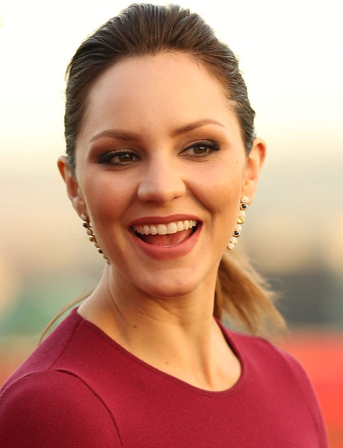 Katharine McPhee shows off a long pair of diamond- and stone-encrusted earrings
