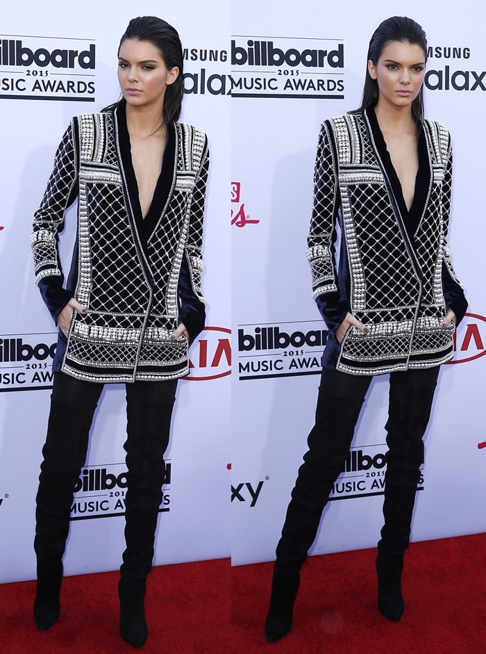 Kendall Jenner paired a pearl-embellished, over-sized jacket paired with black thigh boots