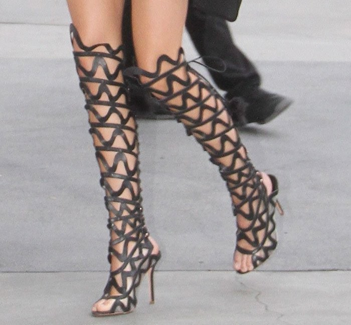 Kendall Jenner's sexy legs in kinky gladiator boots