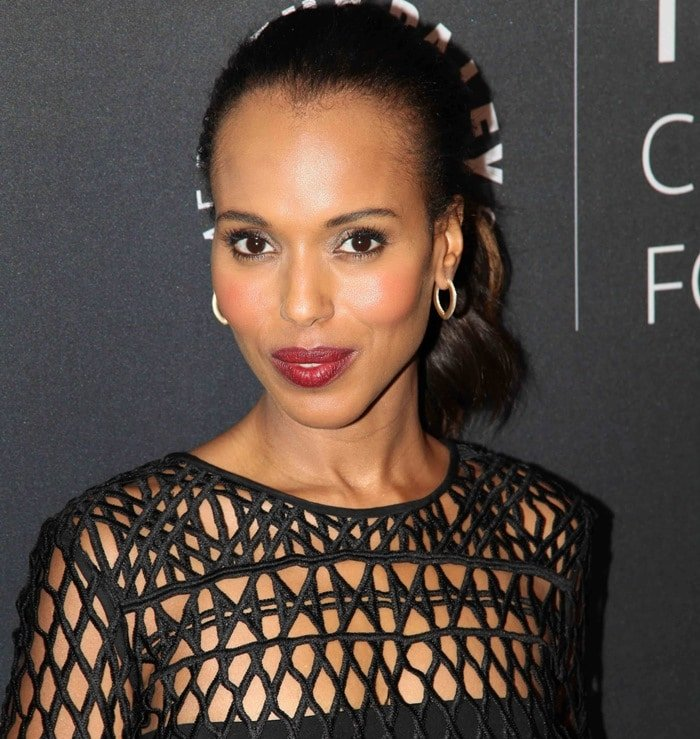 Kerry Washington sported a netted lace Self-Portrait black dress that left her bra and granny panties visible underneath