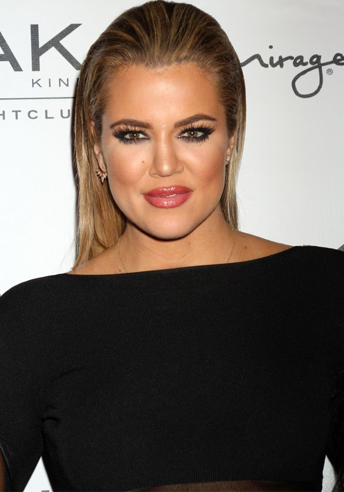 Khloé Kardashian slicked her hair back and layered on the eyelashes for this smoldering look Vegas night look