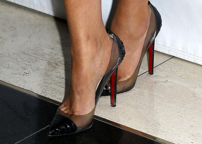 Khloé Kardashian wearing classic black reptile 'Debout' pumps from Christian Louboutin