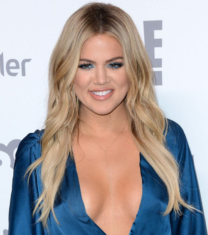 Khloe-Kardashian-flashes-cleavage-in-blue-satin-gown