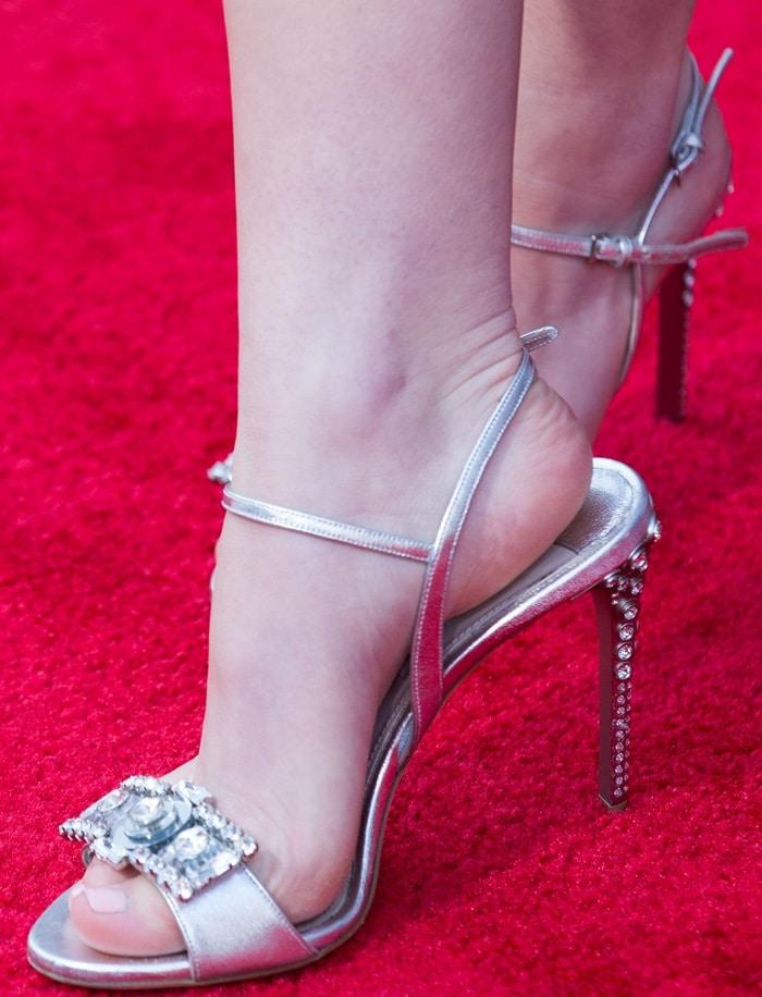 Kiernan Shipka's feet in embellished silver sandals