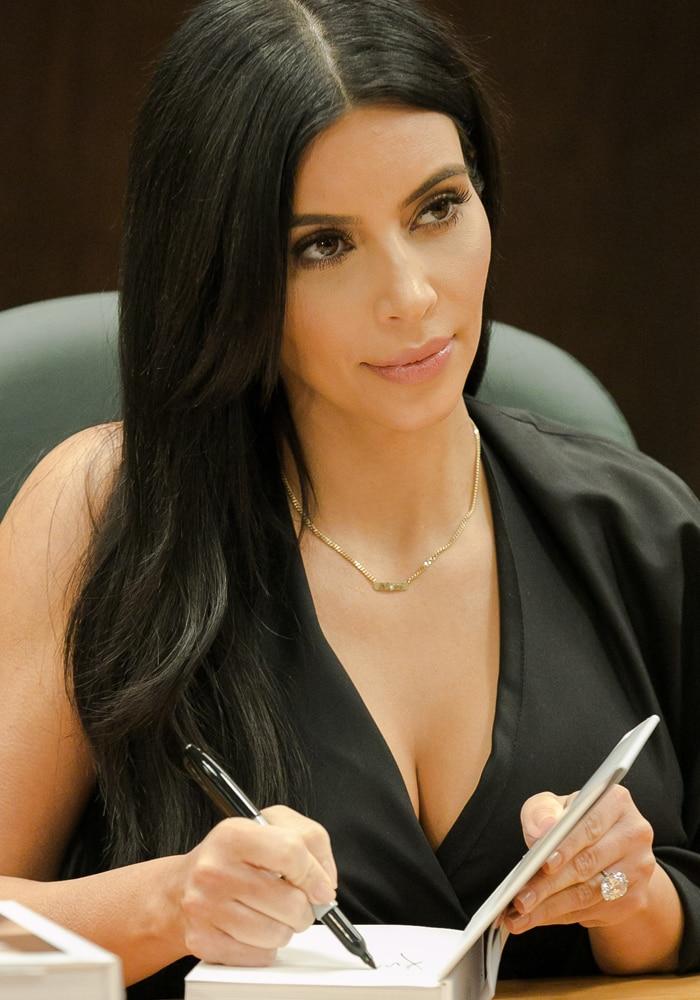 Kim Kardashian signing copies of her new book