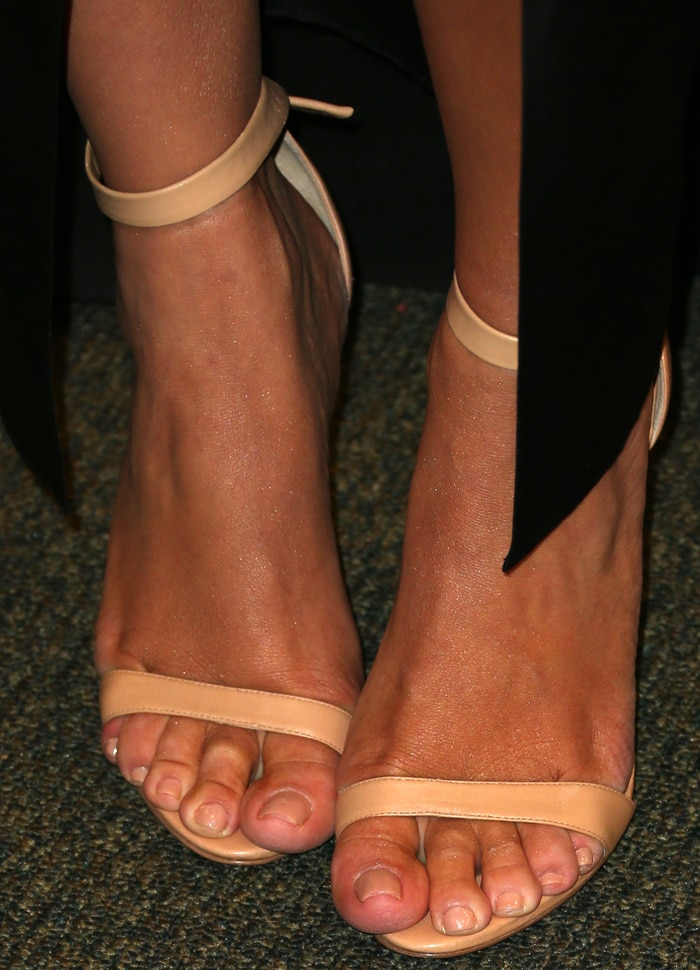 Kim Kardashian showing off her feet in nude ankle-strap sandals