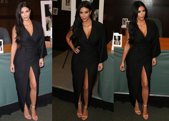 Kim Kardashian was wearing a gorgeous asymmetrical black wraparound dress with a center slit, which she wore with nude heels and minimal jewelry