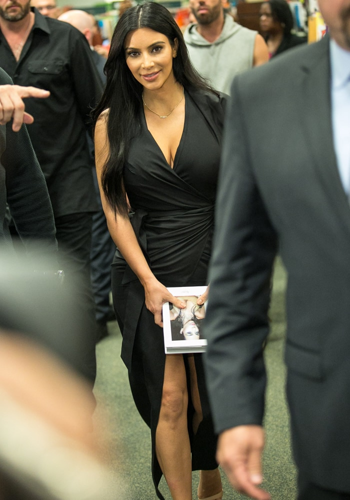 Kim Kardashian West attends a book signing for Selfish, featuring her selfie photography, at Barnes & Noble, The Grove on May 7, 2015