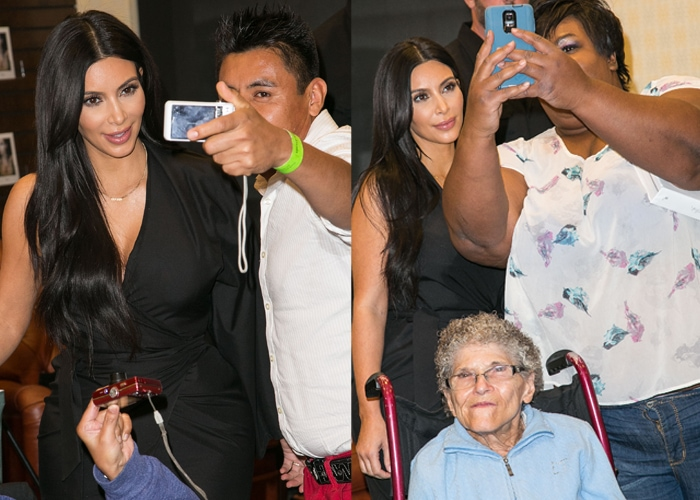 Kim Kardashian West spent time allowing a few fans to take a photo with her before the event began