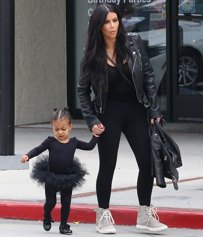 "Kim Kardashian in a glazed leather jacket from BLK featuring custom print stating ""Married"""