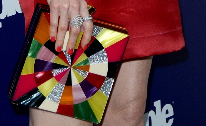 "Darby Stanchfield totes a Kotur ""Fitzgerald Perspex Swirl"" clutch"