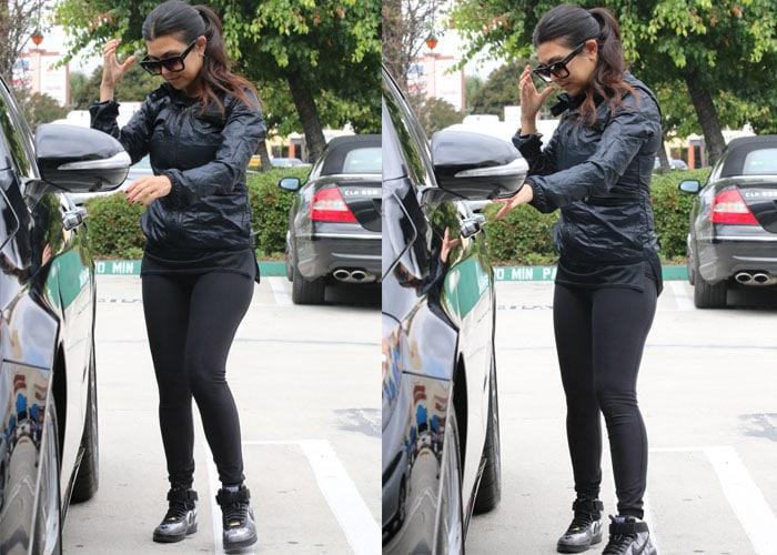 Kourtney Kardashian gets into her black car
