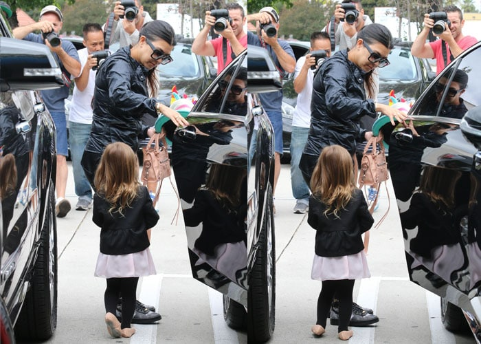 Kourtney Kardashian and her daughter were surrounded by photographers