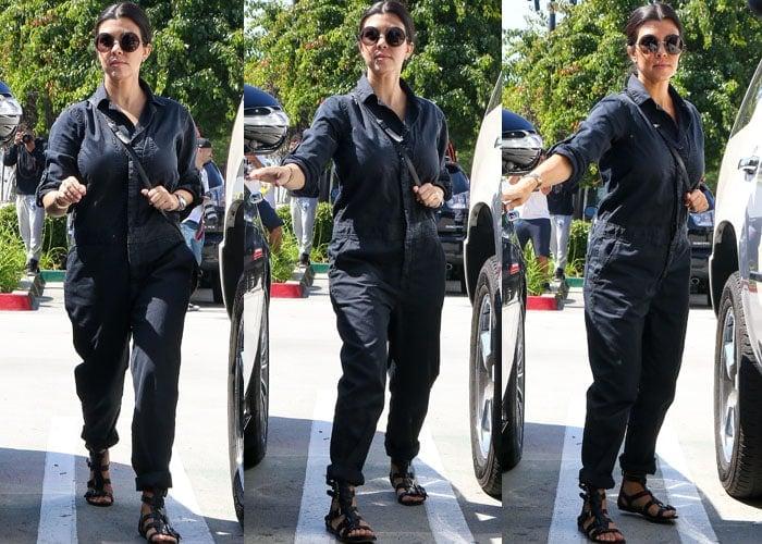 Kourtney Kardashian showed off her post-baby body in dark blue overalls