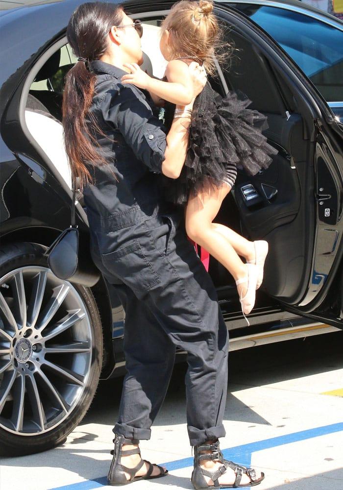 Kourtney Kardashian carried a black, structured shoulder bag