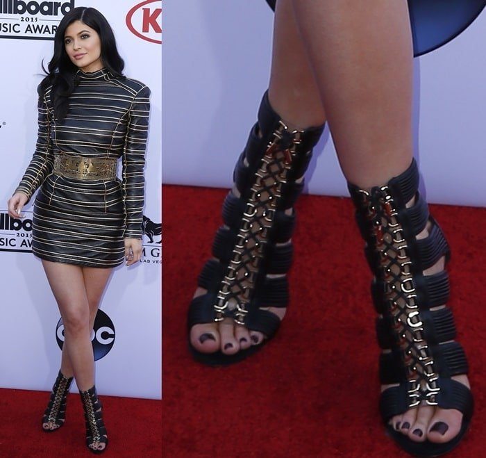 Kylie Jenner showing off her feet in Balmain cage heels
