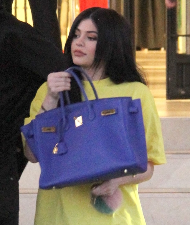 Kylie Jenner shows off her big lips while shopping at Barneys New York