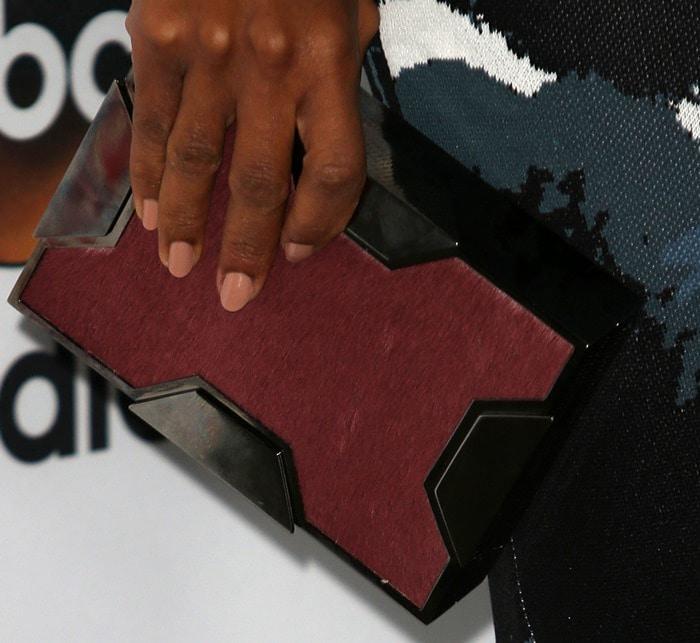 Kerry Washington toted a Lee Savage clutch