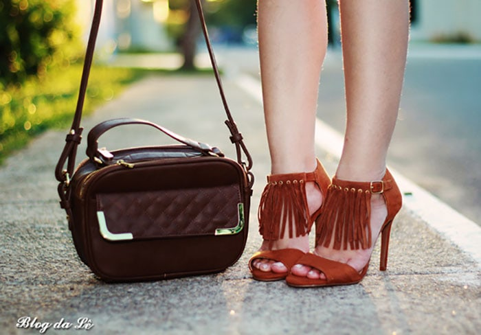 Leticia's hot fringe sandals and chic crossbody bag