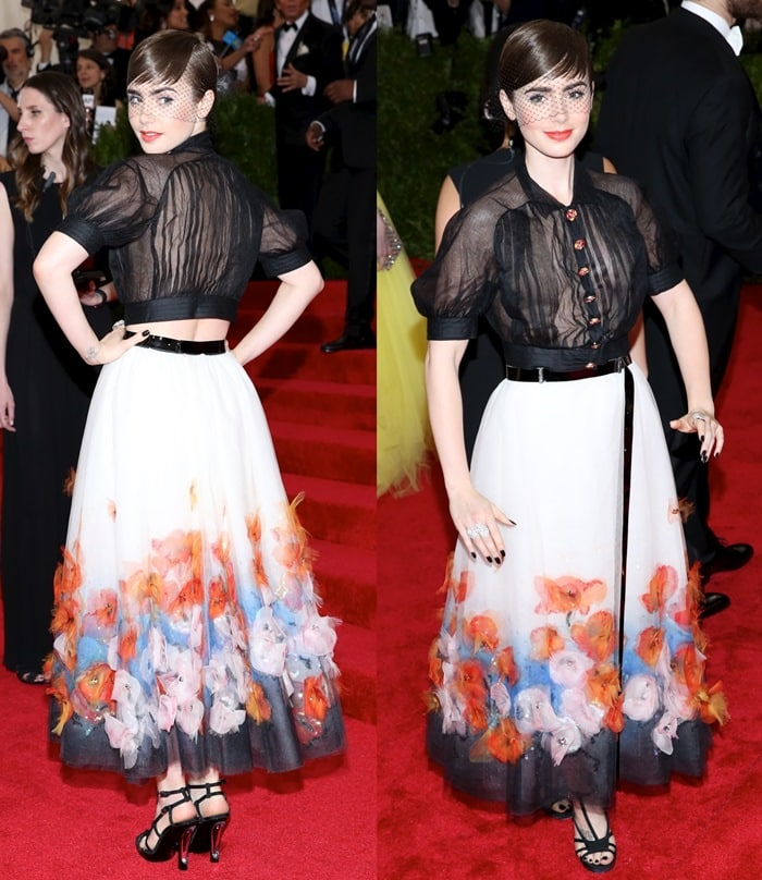 Lily Collins wore a black button-down blouse and a flower-appliqued skirt