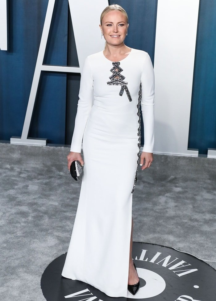 Malin Akerman wears an Antonio Berardi dress while carrying an Atelier Swarovski clutch at the 2020 Vanity Fair Oscar Party