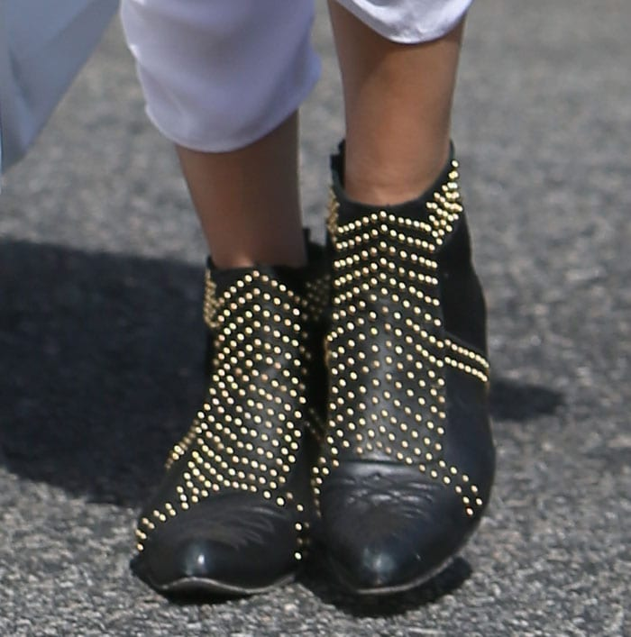 Rendered in a mix of leather and suede and detailed with rows of studs, Malin Akerman's sophisticated booties are truly eye-catching
