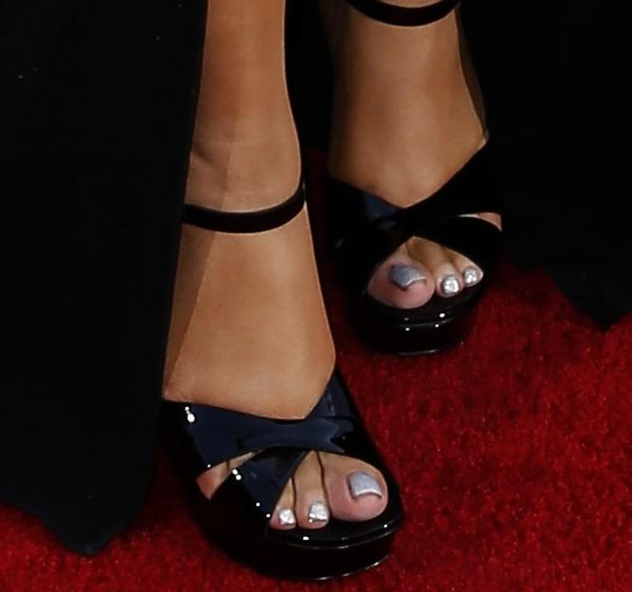 Mariah Carey in black leather Bianca sandals from Saint Laurent