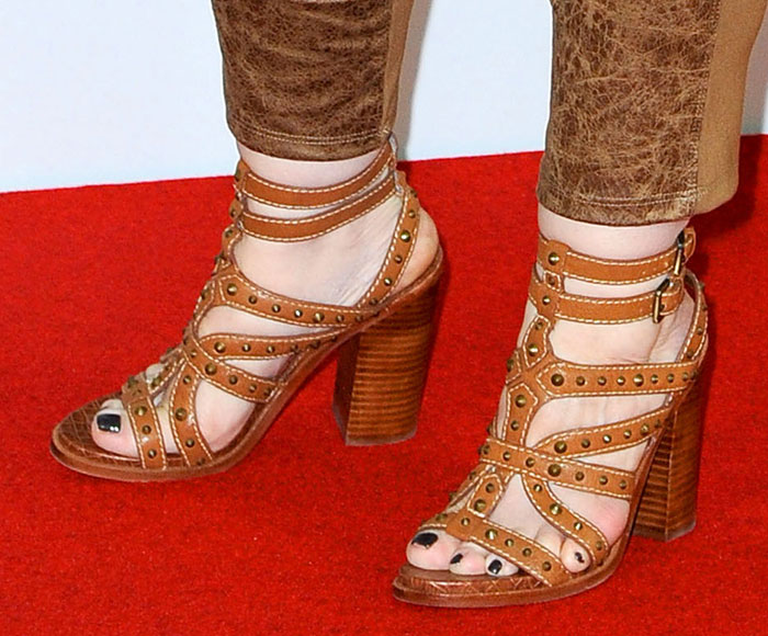 Melissa McCarthy's shoes featuring all-over polished cone stud embellishments