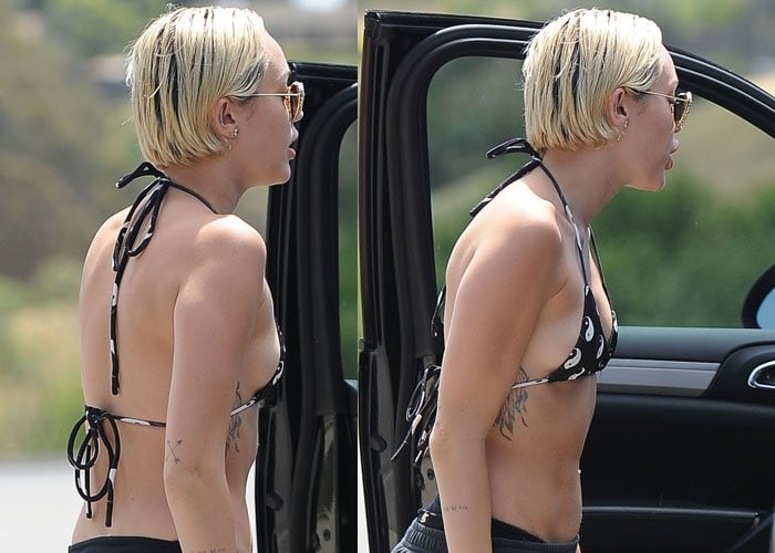 Miley Cyrus giving two big thumbs up as she arrives in Malibu in a bikini and trainers on April 30, 2015