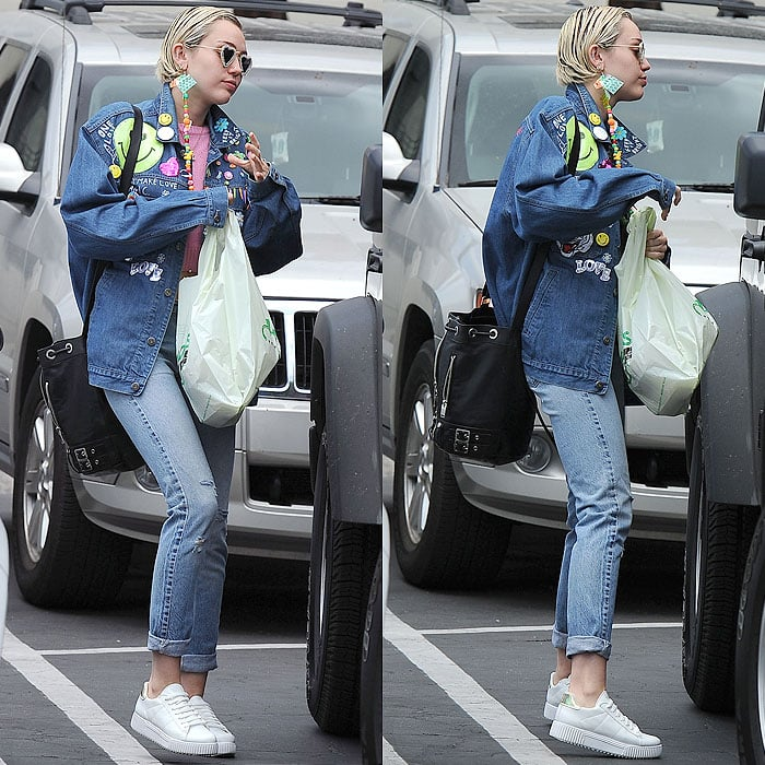 Miley Cyrus carrying a Hugo's Tacos takeout bag