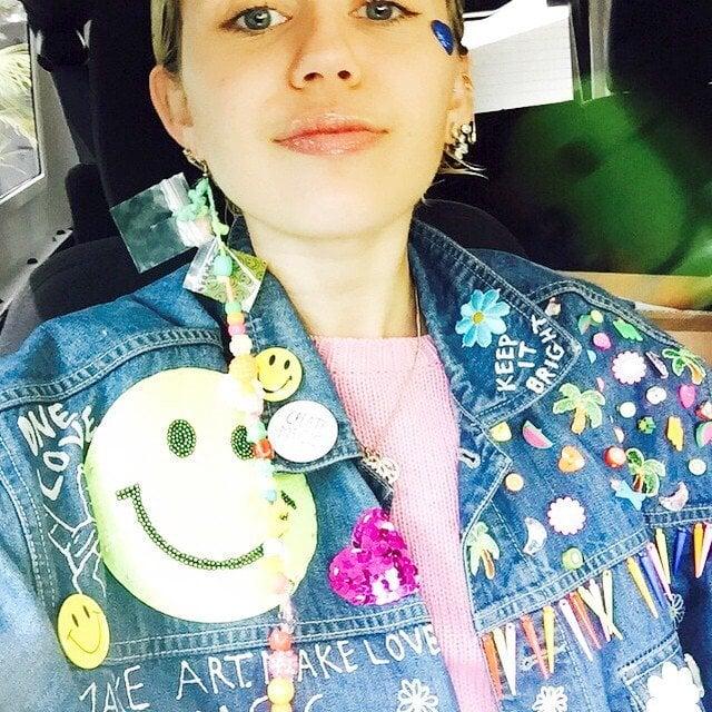 Miley Cyrus wears an oversized denim jacket