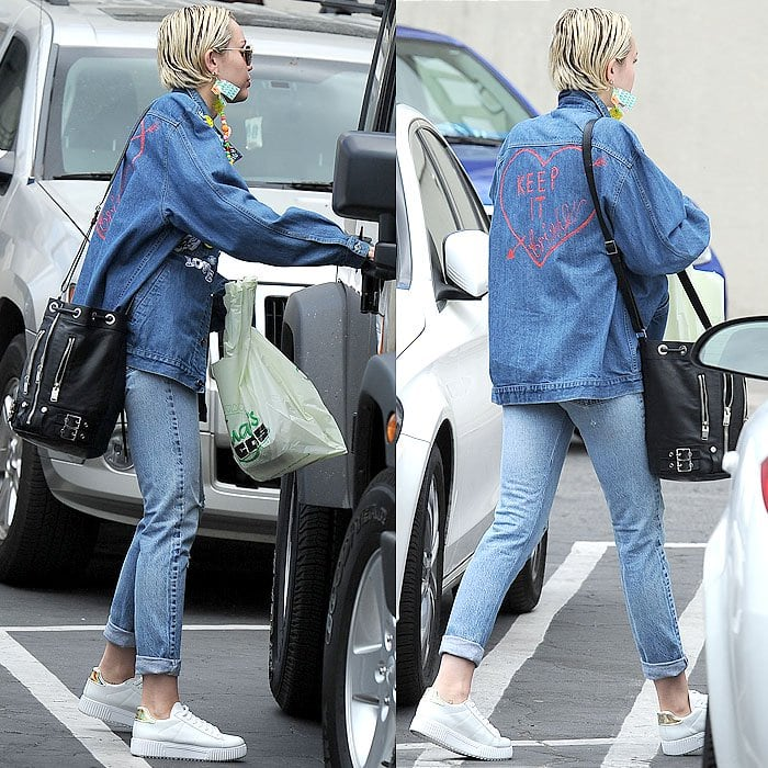 """Miley Cyrus' '90s-themed double-denim ensemble complete with a denim jacket that has """"Keep It Bright"""" scribbled on the back"""