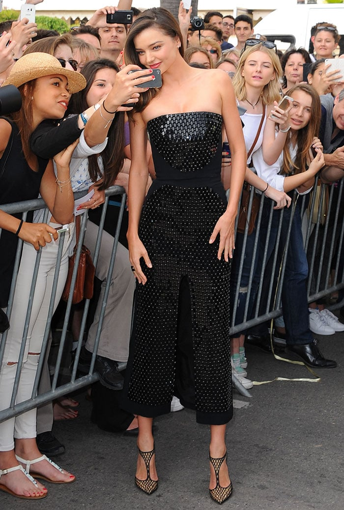 Miranda Kerrflashes her slim legs ina two-piece black outfit by David Koma