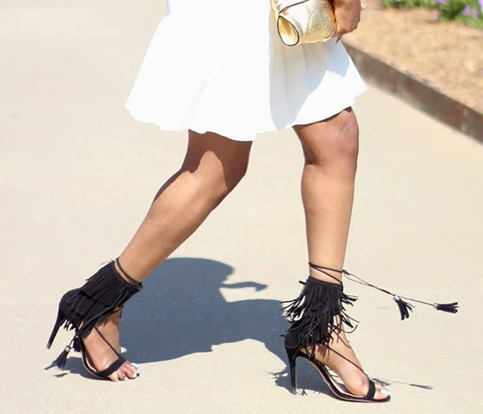 Monica's black fringe sandals