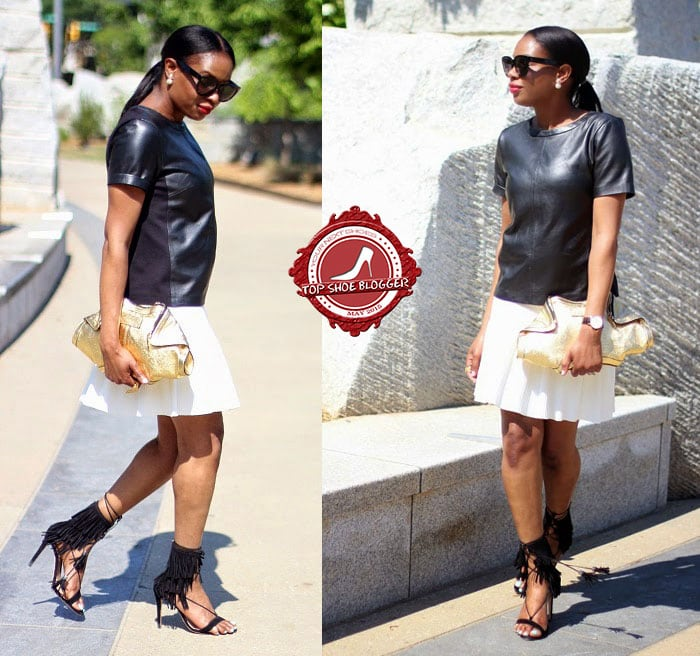 Monica flashed her legs in a leather top and a white skirt