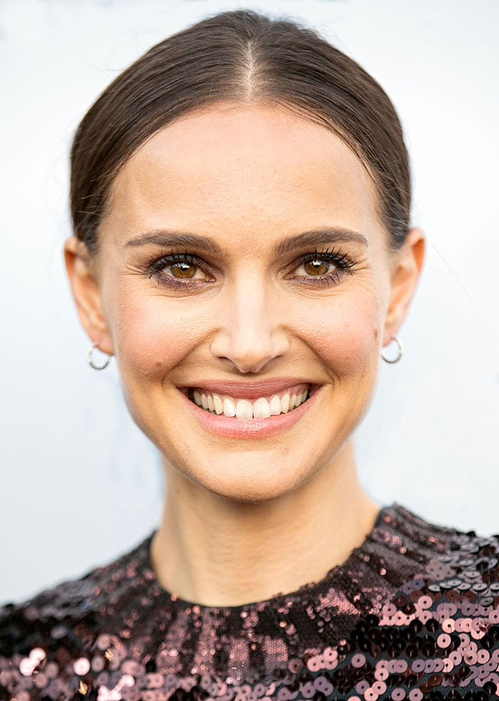 Natalie Portman's brunette hair was pulled back into a sleek low bun with a center parting