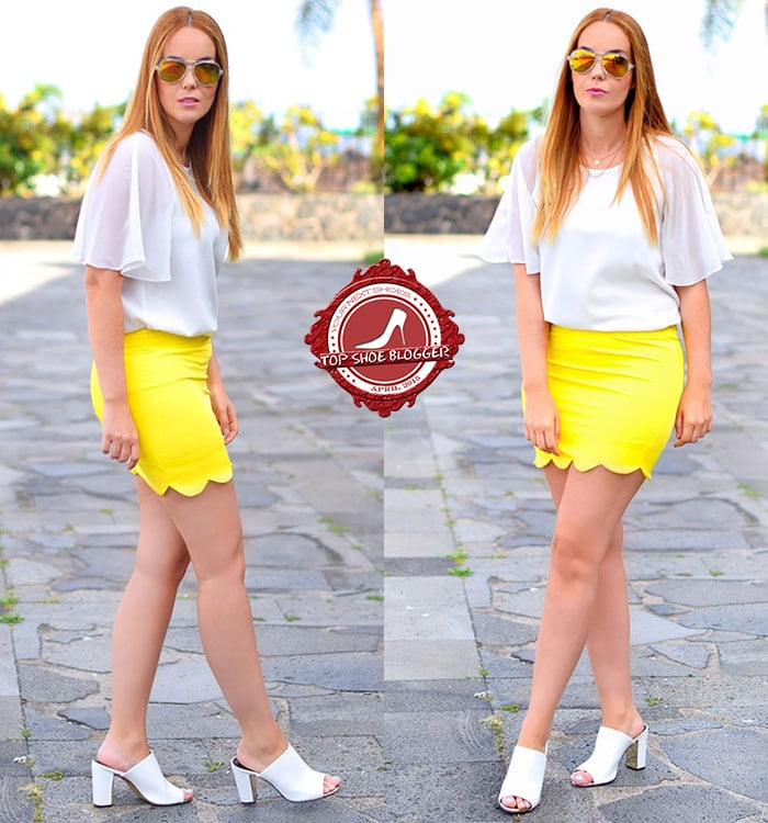 Nery flaunted her legs in a white chiffon blouse paired with a bright yellow scalloped skirt
