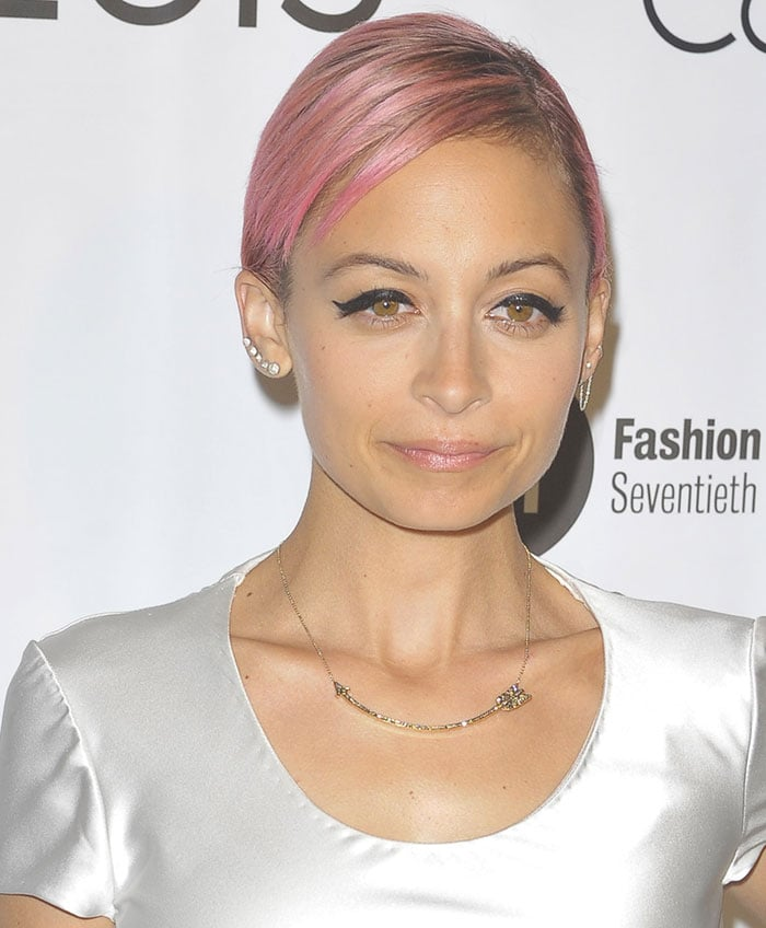 Nicole Richie's dramatic makeup with heavy winged eyeliner and pale pink lipstick