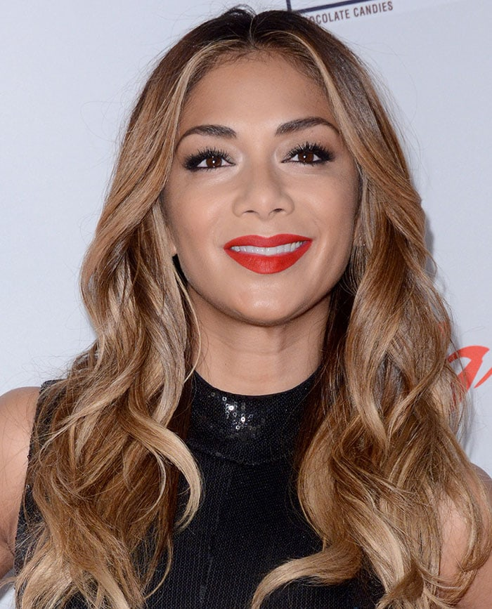 Nicole Scherzinger let her long hair fall loosely around her shoulders