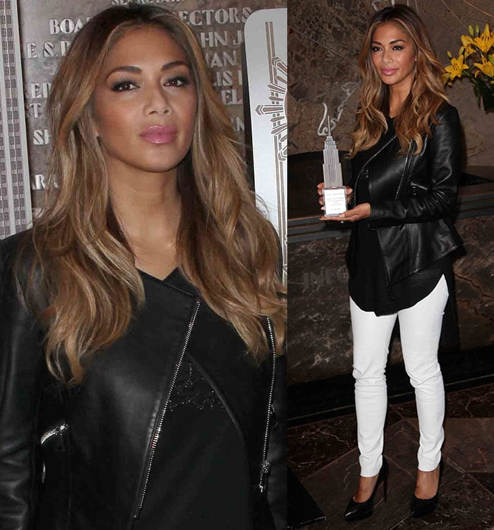Nicole Scherzinger wore white pants with a black top and a black leather jacket