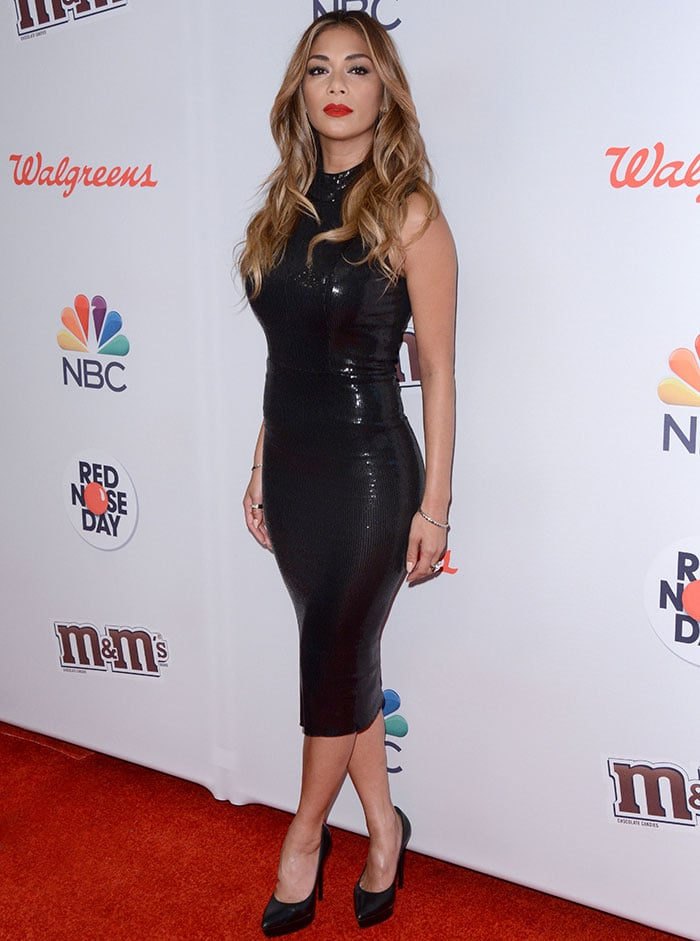 Nicole Scherzinger squeezed her enviable curves into a skin-tight sleeveless black dress